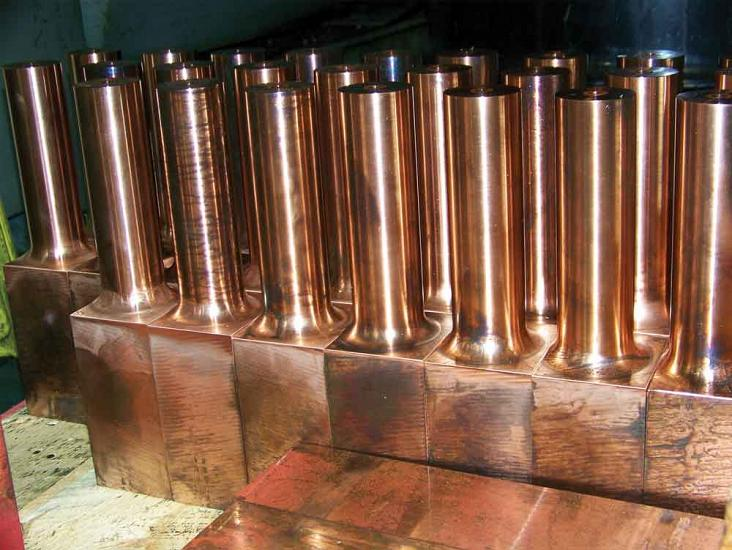 Copper adaptor blocks used on aluminum gun arm for robotic welding are ready for secondary machining.